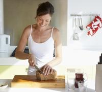 636595706144381596Woman-in-kitchen-slicing-bread.jpg