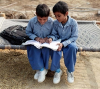 636743487482732339indian kids child children reading.jpg