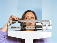 636759697086305350woman scales weight.jpg