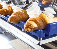 Schubert fills and packs 160 croissants a minute in single fully-automated system