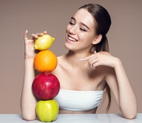 636836585777466009woman happy fruit healthy.jpg